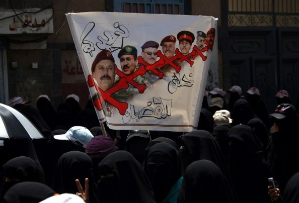 Yemeni women  holding up a banner showin
